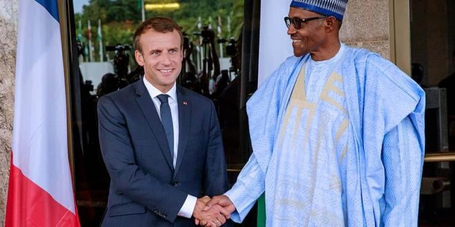 President-Buhari-in-a-handshake-with-President-Macron-